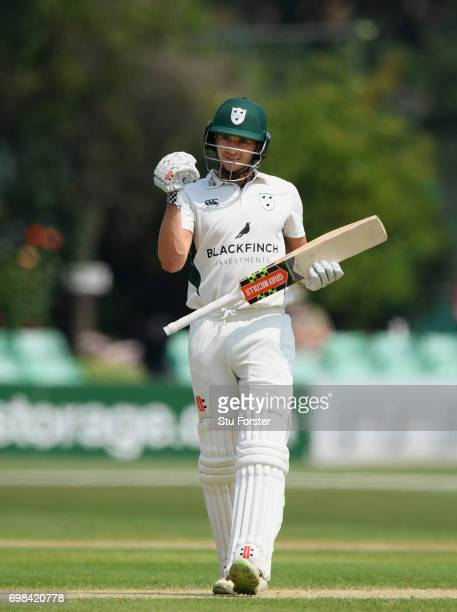 Worcestershire batsman Joe Clarke reaches his century during the Specsavers County Championship Division Two between Worcestershire and Kent at New...