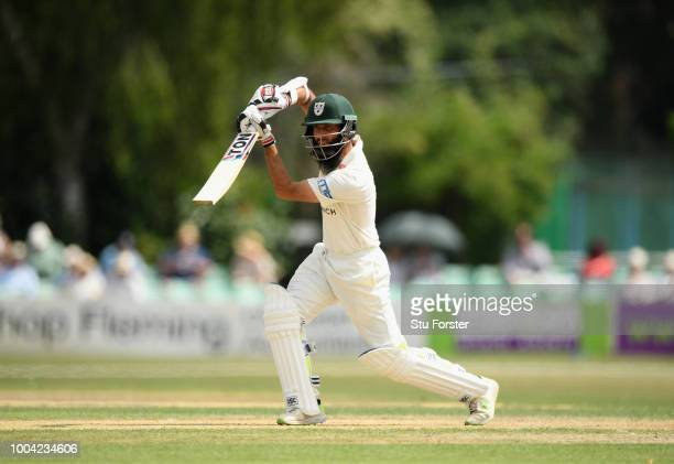 Worcestershire batsman Moeen Ali cover drives to the boundary during Day two of the Specsavers County Championship Division One match between...