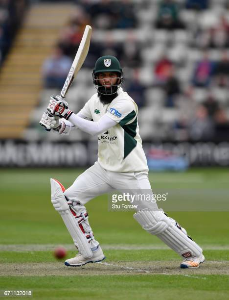 Worcestershire batsman Moeen Ali cover drives to the boundary during day one of thr Specsavers County Championship Division Two at New Road on April...