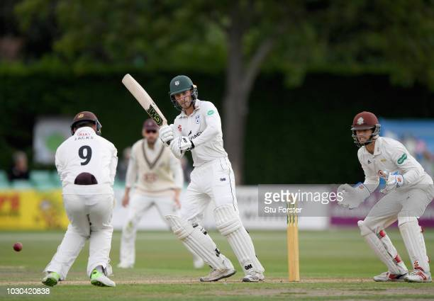 Worcestershire batsman Tom Fell pulls the ball past fielder Will Jacks as wicketkeeper Ben Foakes looks on during day one of the Specsavers County...
