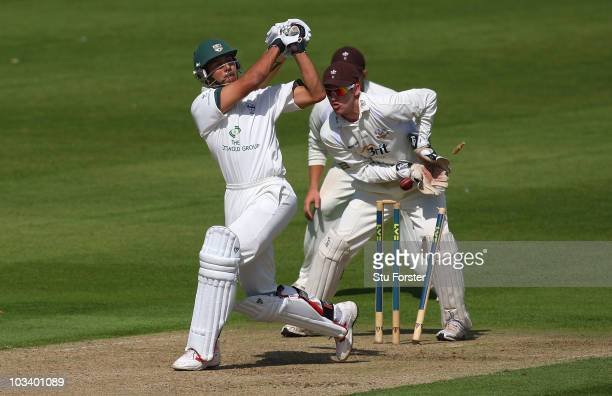 Worcestershire batsman Vikram Solanki is bowled by Gareth Batty as wicketkeeper Steven Davies celebrates during the LV County Championship division...
