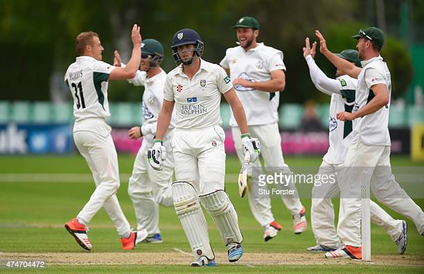 Worcestershire bowler Charlie Morris and team mates celebrate after taking the wicket of Calum MacLeod on day two of the LV County Championship...