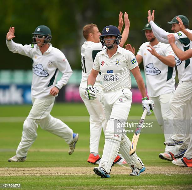 Worcestershire bowler Charlie Morris and team mates celebrate after taking the wicket of Calum MacLeod caught by Richard Oliver during day two of the...