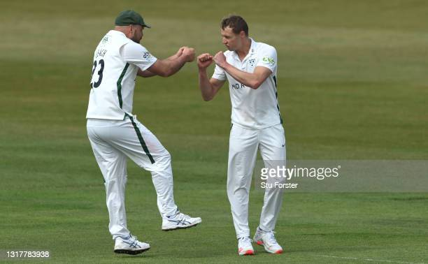 Worcestershire bowler Charlie Morris is congratulated by Joe Leach after taking the wicket of Scott Borthwick during day one of the LV=Insurance...