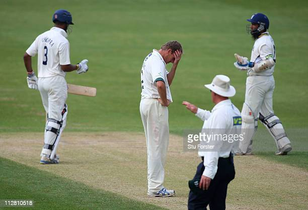 Worcestershire bowler Damien Wright looks on dejectedly as Warwickshire batsmen Varun Chopra and Mohammad Yousuf pick up some more runs during day...