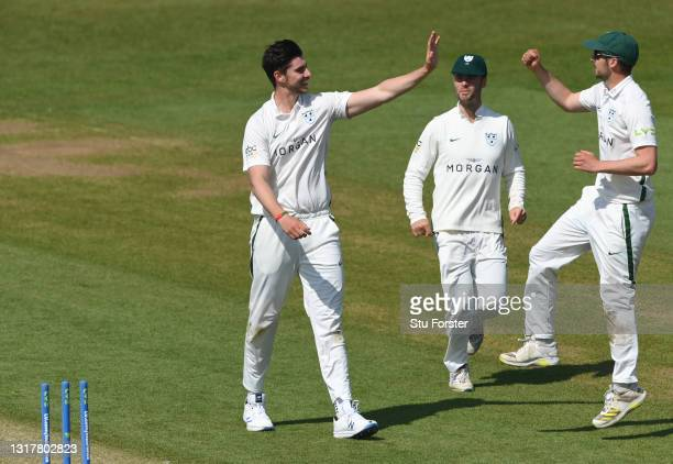 Worcestershire bowler Josh Tongue celebrates with team after taking the wicket of Jack Burnham during day one of the LV=Insurance County Championship...