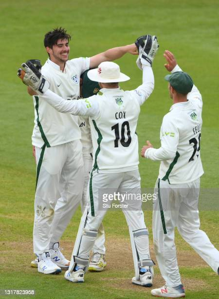 Worcestershire bowler Josh Tongue celebrates with team mates after taking his fifth wicket of the innings during day one of the LV=Insurance County...