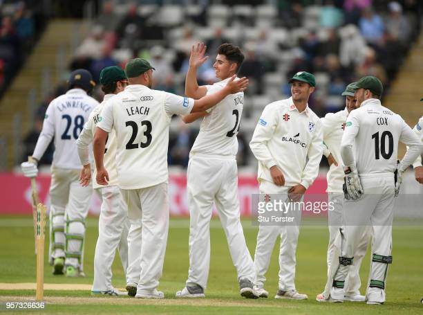 Worcestershire bowler Josh Tongue is congratulated after bowling Daniel Lawrence during day one of the Specsavers County Championship Division One...
