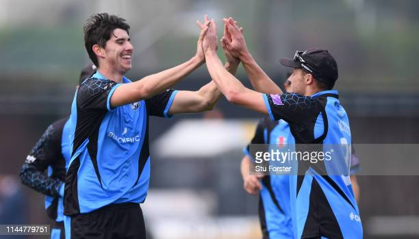 Worcestershire bowler Josh Tongue is congratulated after taking the wicket of Graham Clark during the Royal London One Day Cup match between...