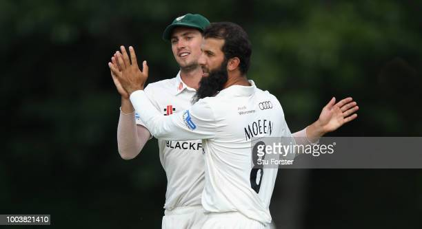 Worcestershire bowler Moeen Ali celebrates with Ed Barnard after dismissing Steven Davies during Day One of the Specsavers County Championship...