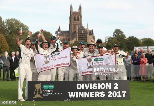 Worcestershire celebrate after winning the Specsavers County Championship division two title after their victory during the Specsavers County...