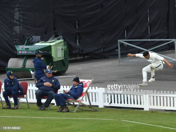 Worcestershire fielder Brett D'Oliveira hurdles the picket fence beyond the boundary as the Durham groundstaff look on during Day three of the LV=...