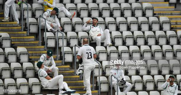 Worcestershire players wait in the stand after the players went off for bad light during the Bob Willis Trophy match against Somerset at New Road on...
