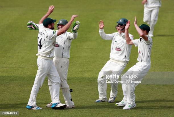 Worcestershire's Ross Whiteley is congratulated by team mates after running out Derbyshire's David Wainwright during day four of the LV= County...