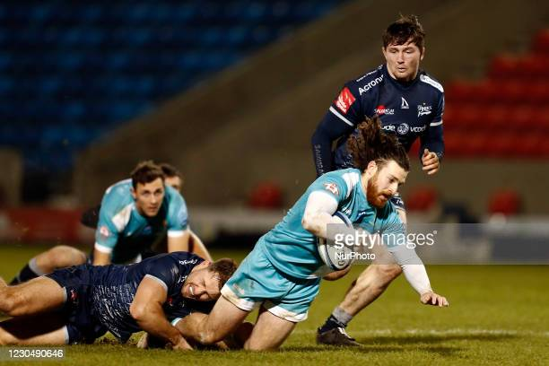 Worchesters Ali Morris is brought to the ground during the Gallagher Premiership match between Sale Sharks and Worcester Warriors at AJ Bell Stadium,...