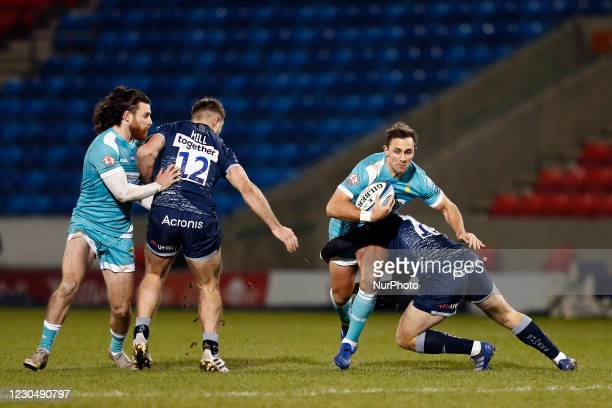 Worchesters Ashley Beck is tackled by Sales 16. Curtis during the Gallagher Premiership match between Sale Sharks and Worcester Warriors at AJ Bell...
