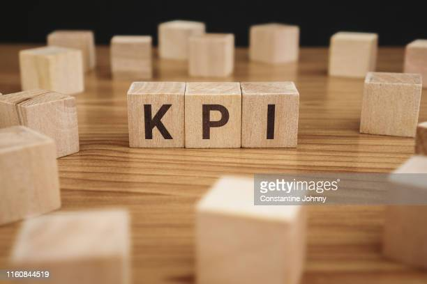 kpi word on wooden block. key performance indicator. - business strategy stock pictures, royalty-free photos & images