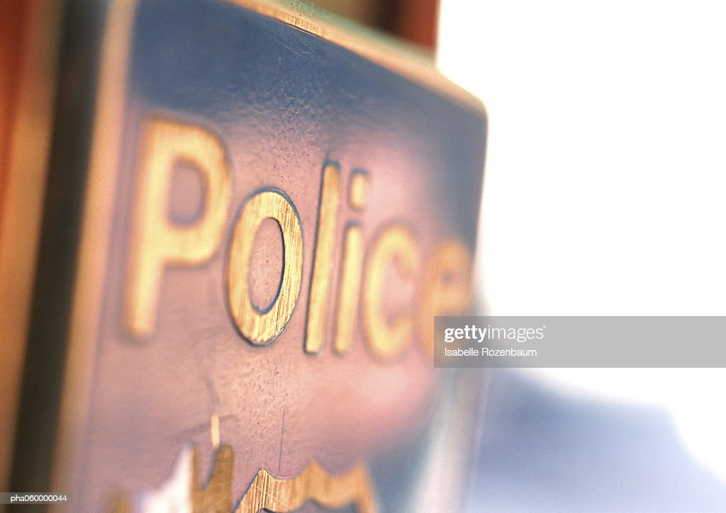 Word police on signpost, close-up : Stock Photo