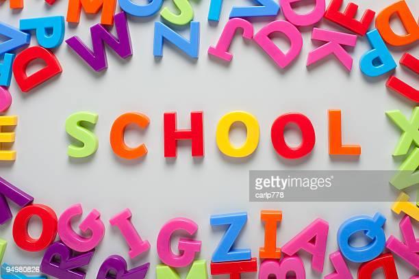 Word 'school' spelled out on board
