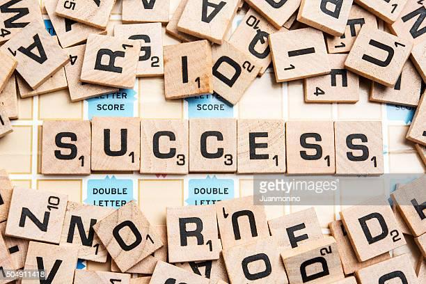 Word SUCCESS in Scrabble Letters