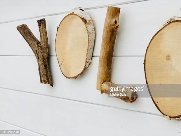word 'yolo' made of wood pieces - 東フランダース ストックフォトと画像