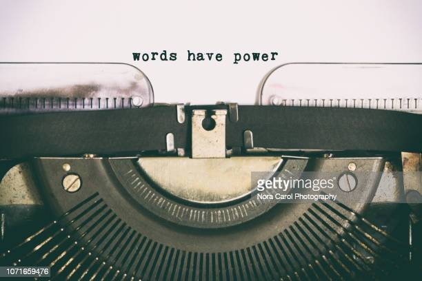 words have power text  typed on vintage typewriter - single word stock pictures, royalty-free photos & images