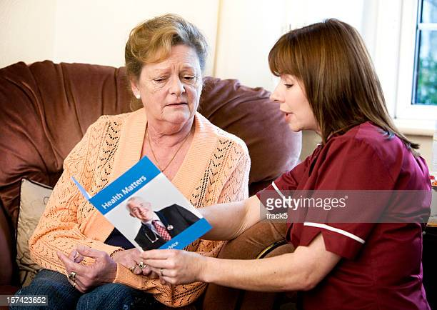 words of advice from a care nurse providing advice - flyer leaflet stock pictures, royalty-free photos & images