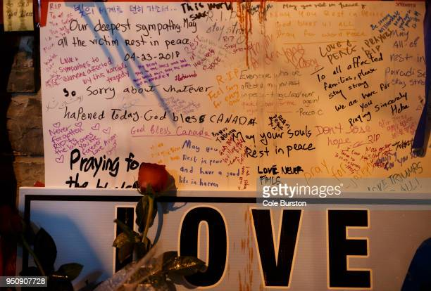 Words of sympathy adorn a makeshift card at a vigil for the victims of the mass killing on April 24 2018 in Toronto Canada A suspect identified by...