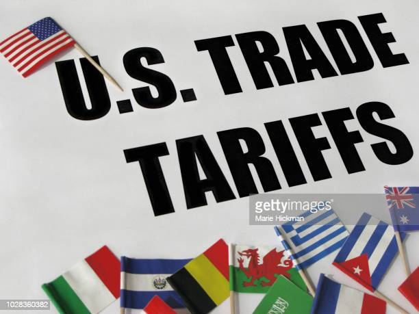 """words """"u.s. trade tariffs"""" with u.s. flag and some flags from around the world. - tariff stock pictures, royalty-free photos & images"""