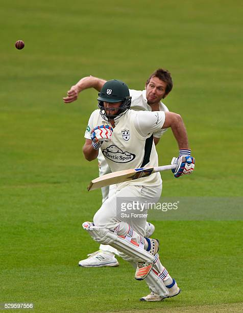 Worecstershire batsman Ross Whiteley races for his crease as Glamorgan bowler Michael Hogan throws at the stumps during day two of the Specsavers...