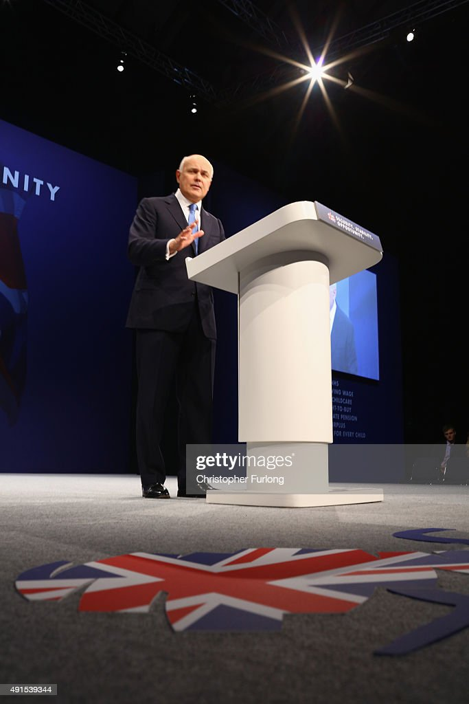 Work and Pensions Secretary Iain Duncan Smith delivers his keynote speech to delegates during the Conservative Party Conference on October 6, 2015 in Manchester, England. Home Secretary Theresa May addressed delegates on day three of the Conservative Party conference at Manchester Central and warned that it is 'impossible to build a cohesive society' and the UK needs to have an immigration limit.
