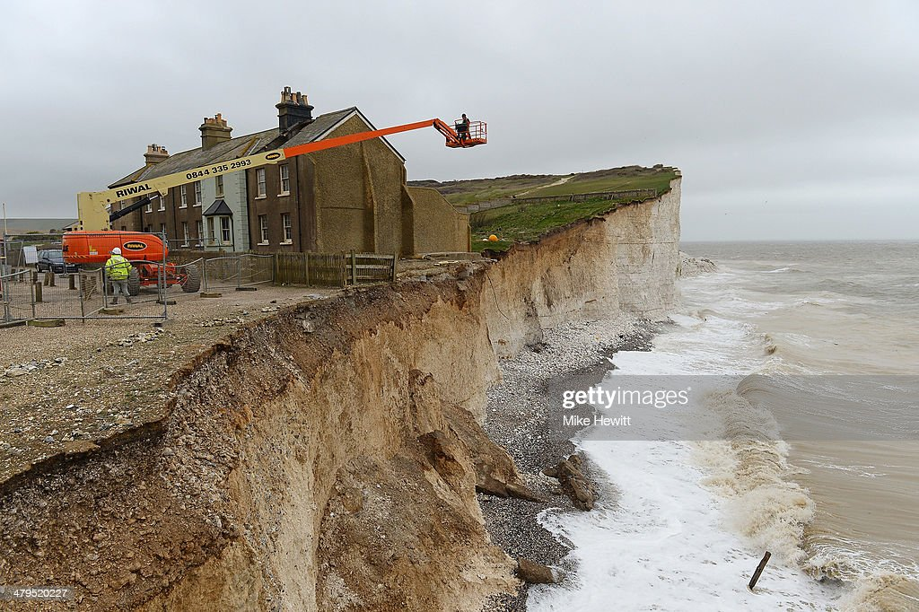 Work begins today to demolish the end terrace cottage at Birling Gap on March 19, 2014 near Eastbourne, United Kingdom. The ex-coastguard cottage was in danger of collapsing after cliff erosion and was once one of seven properties, two of which were already demolished in the last two decades. The council said the next cottage in line would only have up to ten years before it too succumbs to the erosion.