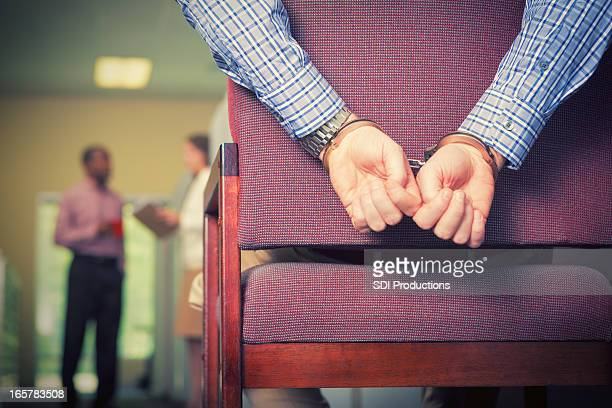 work bondage: corporate man with handcuffs in office context - man tied to chair stock photos and pictures