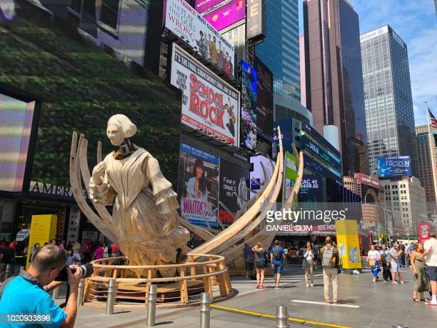 A work by American conceptual artist Mel Chin is displayed on New Yorks Times Square August 21 2018