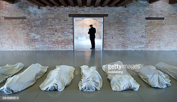 Work by artist Maurizio Cattelan ' All' nine sculptures in white Carrara marble at the opening of the Exhibition In Praise of Doubt at Punta della...