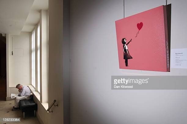 A work by Banksy entitled 'Balloon Girl' is displayed at Bonhams Auction house on September 16 2011 in London England The piece makes up part of the...