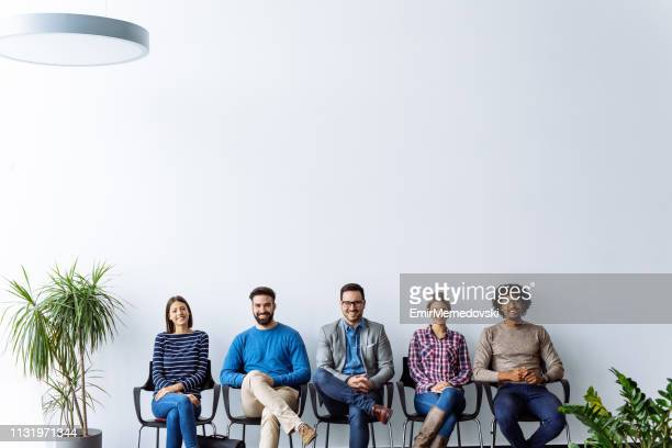 work candidates waiting for job interview - human resources stock pictures, royalty-free photos & images