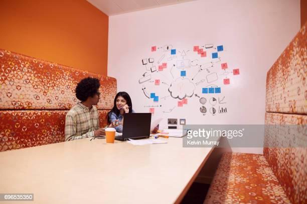 Work colleagues brainstorming in creative office
