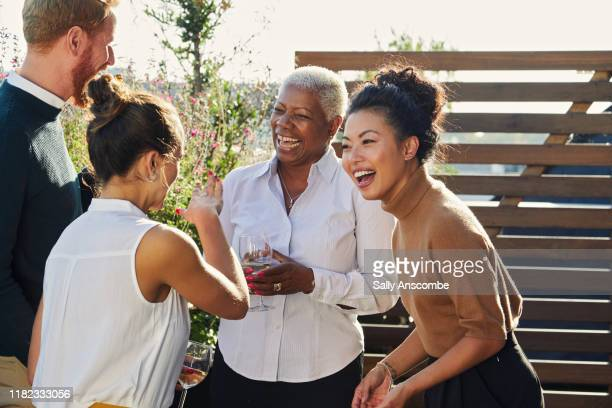 work colleagues celebrating with a drink after work - sally anscombe stock pictures, royalty-free photos & images