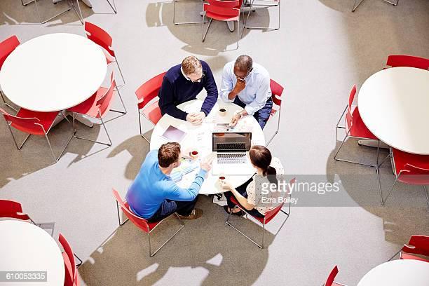 Work colleagues having an impromptu meeting.