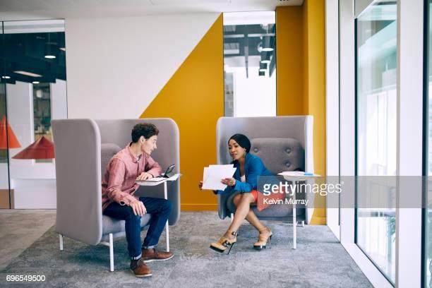 Work colleagues having meeting in creative office