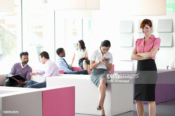 Work colleagues in busy workplace