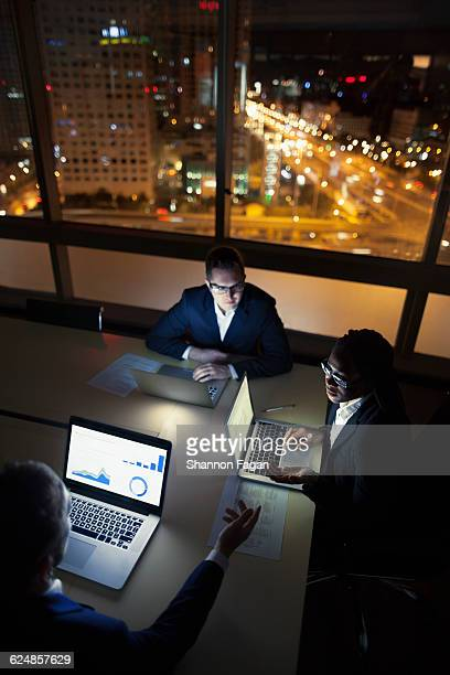 Work colleagues in conference room at night