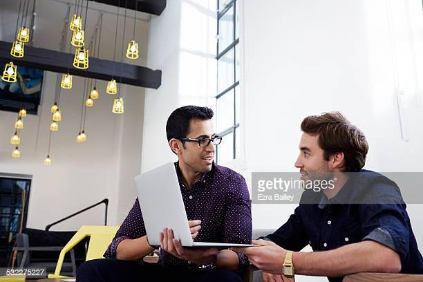 Work colleagues in modern office brainstorming.