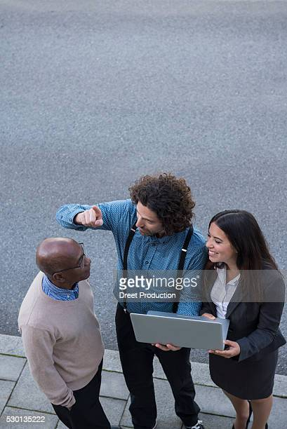 Work colleagues meeting laptop computer African