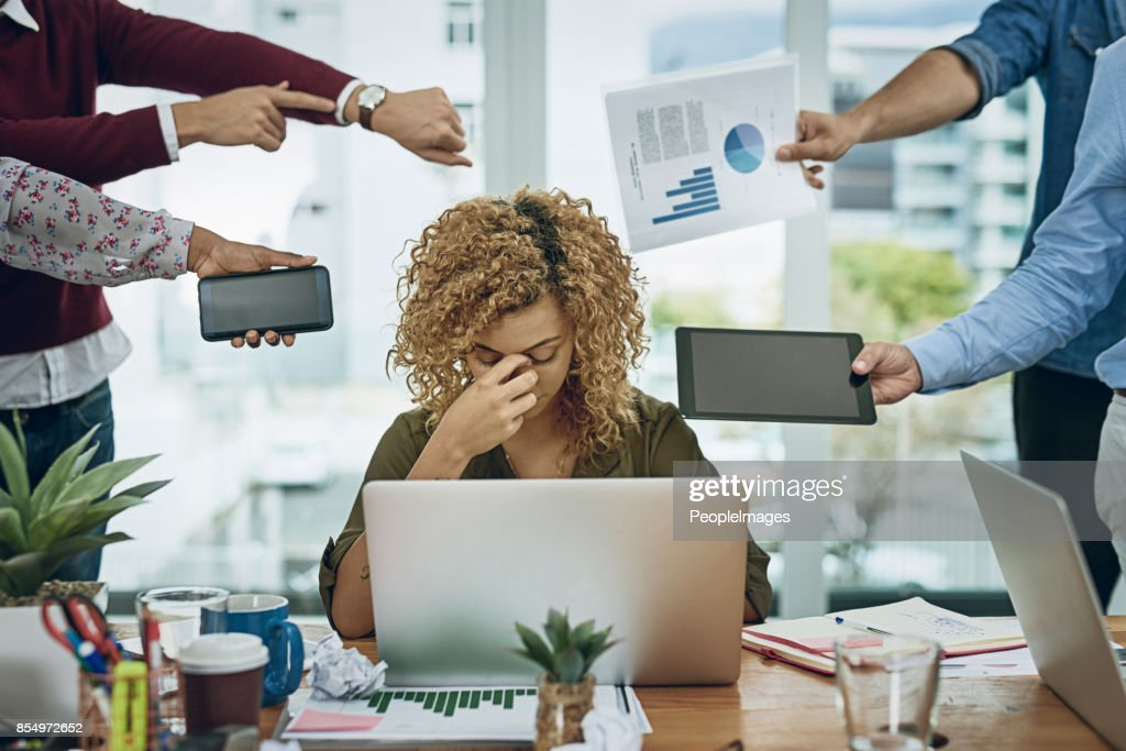 Work commitments are closing in on her : Stock Photo