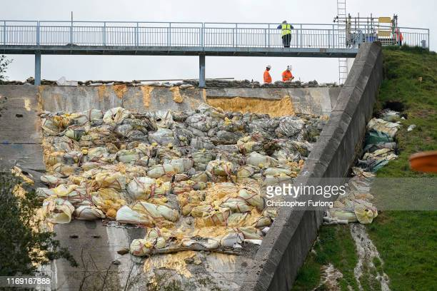 Work continues at the Whaley Bridge Dam site to shore up the damaged dam on August 20 2019 in Whaley Bridge England Approximately 1500 residents of...