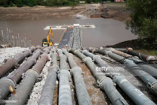 Work continues at the Whaley Bridge Dam site to shore up the damaged dam wall on August 21, 2019 in Whaley Bridge, England. Approximately 1,500...