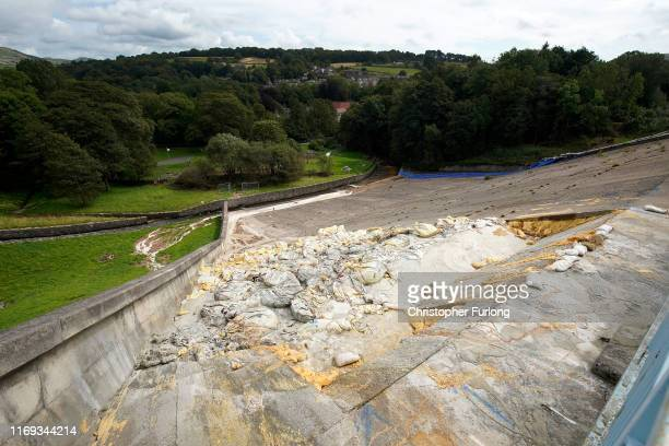 Work continues at the Whaley Bridge Dam site to shore up the damaged dam wall on August 21 2019 in Whaley Bridge England Approximately 1500 residents...
