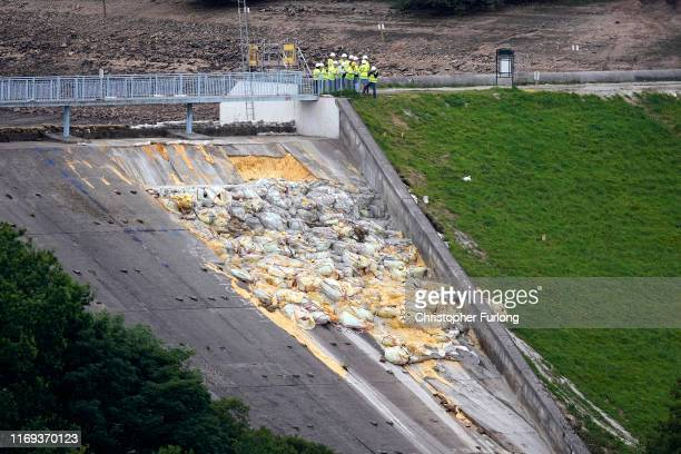 Work continues at the Whaley Bridge Dam site to shore up the damaged dam on August 20, 2019 in Whaley Bridge, England. Approximately 1,500 residents...